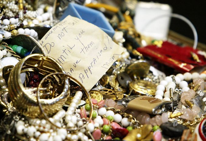 Costume jewelry was among the mass of stolen goods from at least 24 burglaries in rural New York. In an attempt to find the owners of the 30,000 items seized, police displayed them Wednesday night at a high school. (Associated Press)