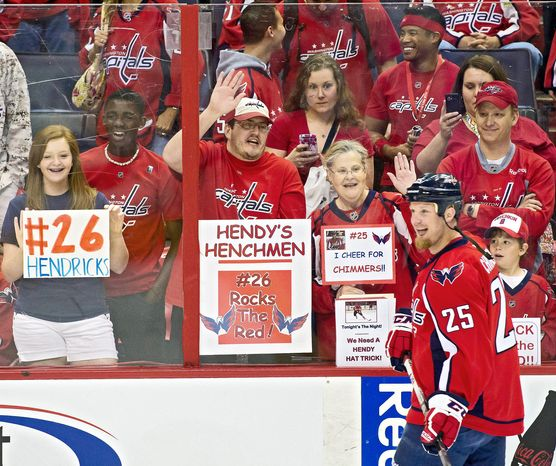Fans cheered as Capitals left wing Jason Chimera (25) warmed up before Washington's playoff game against the New York Rangers on May 2 at Verizon Center. (Andrew Harnik/The Washington Times)