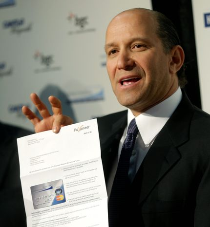"""The best way to take care of a family is to put money in the hands of the parents and let them decide what to do,"" Cantor Fitzgerald CEO Howard Lutnick says of the $10 million worth of $1,000 debit cards his company is giving to Superstorm Sandy victims in 19 schools. (Associated Press)"