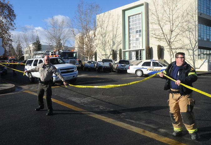 **FILE** Officials tape off an area outside San Joaquin Valley High School in Taft, Calif., on Jan. 10, 2013. Authorities said a student was shot and wounded and another student was taken into custody. (Associated Press/Taft Midway Driller, Doug Keeler)