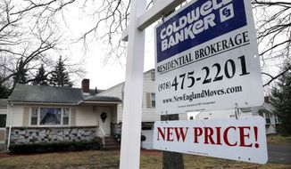 ** FILE ** In this Thursday, Dec. 20, 2012, photo, a sign hangs in North Andover, Mass., where an existing home is for sale. Average U.S. rates on fixed mortgages moved closer to their record lows this week, a trend that has made home buying more affordable and helped sustain a housing recovery. (AP Photo/Elise Amendola)