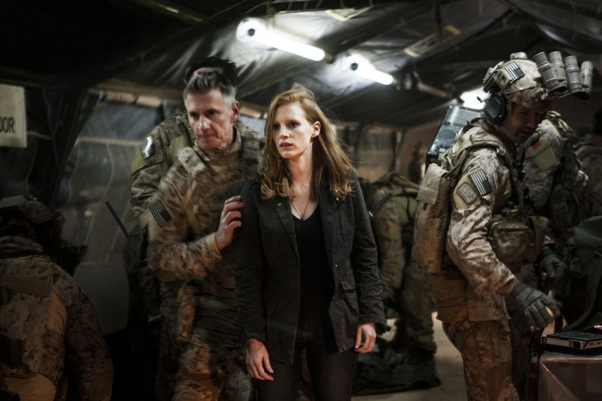 "Jessica Chastain (center) plays a member of the elite team of spies and military operatives who secretly devote themselves to finding Osama Bin Laden in Columbia Pictures' new thriller, ""Zero Dark Thirty."" (Associated Press/Columbia Pictures Industries, Inc.)"
