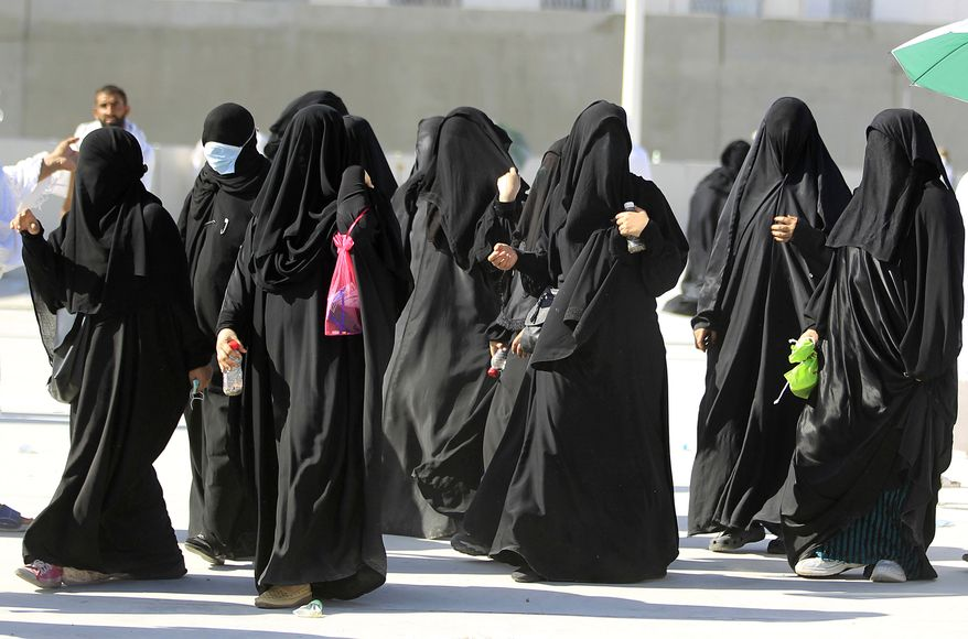 "**FILE** Muslim women pilgrims make their way to throw cast stones at a pillar, symbolizing the stoning of Satan, in a ritual called ""Jamarat,"" the last rite of the annual hajj, in Mina near the Saudi holy city of Mecca, Saudi Arabia, on Nov. 6, 2011. (Associated Press)"
