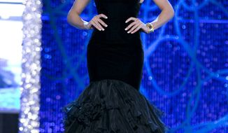 This photo courtesy Miss America Organization shows Miss DC, Allyn Rose, during the Evening Wear portion of preliminary competition at the 2013 Miss America Pageant in Las Vegas on Jan. 8, 2013. The 24-year-old plans to undergo a double mastectomy after the event as a preventative measure to reduce her chances of developing the disease that killed her mother, grandmother and great aunt. (Associated Press/Courtesy Miss America Organization)