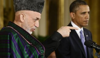 Afghan President Hamid Karzai takes questions from reporters during his joint news conference with President Obama in the East Room of the White House in Washington on Jan. 11, 2013. (Associated Press)