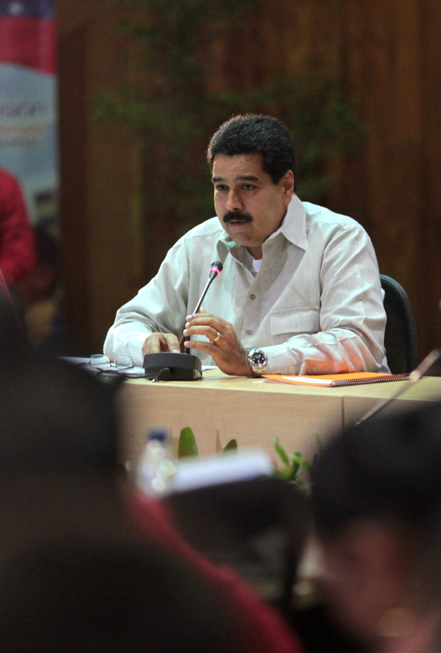 Venezuelan Vice President Nicolas Maduro speaks on Friday, Jan. 11, 2013, during a meeting with members of the Cabinet in Caracas, Venezuela. (Associated Press/Miraflores Press Office)