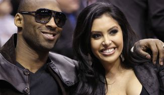 ** FILE ** This Feb. 13, 2010, file photo shows Los Angeles Lakers' Kobe Bryant and his wife, Vanessa, attending the skills competition at the NBA basketball All-Star Saturday Night in Dallas. The Los Angeles Lakers superstar and his wife both announced they've called off their divorce Friday, Jan. 11, 2013, on social media. (AP Photo/LM Otero, File)