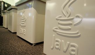 ** FILE ** This April 23, 2007, file photo shows the Java logo at Sun Microsystems' offices in Menlo Park, Calif. (AP Photo/Paul Sakuma, File)
