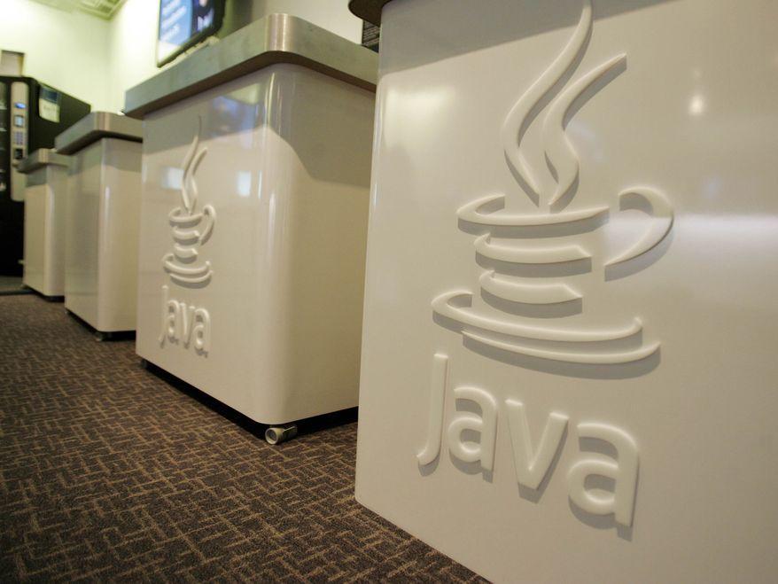 ** FILE ** This April 23, 2007, file photo shows the Java logo at Sun Microsystems' offices in Menlo Park, Calif. (AP Photo/Paul Sakuma, File)
