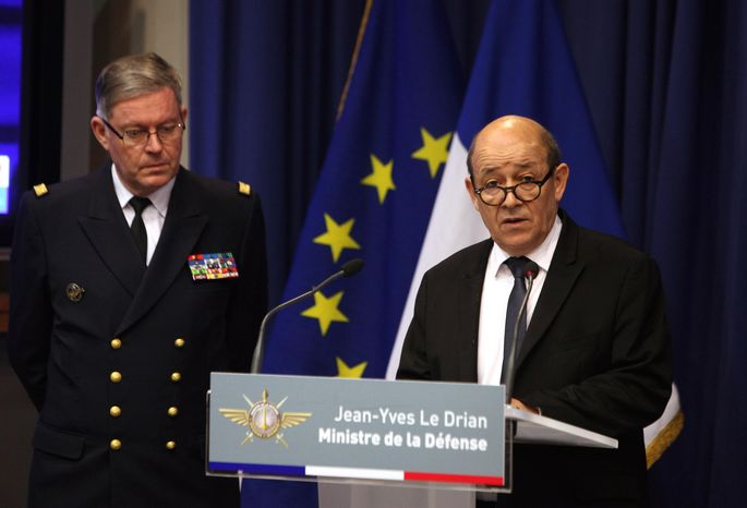 French Defense Minister Jean-Yves Le Drian (right) speaks as Adm. Edouard Guillaud, the French army chief of staff, stands by during a press conference in Paris on Saturday, Jan. 12, 2013. Mr. Le Drian said hundreds of French troops are involved in an operation that destroyed a command center of Islamic rebels in Mali. (AP Photo/Thibault Camus)