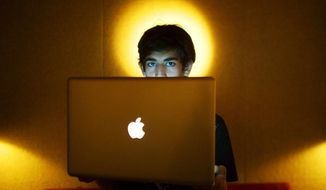 ** FILE ** In this Jan. 30, 2009, photo, Internet activist Aaron Swartz poses for a photo in Miami Beach, Fla. Swartz was found dead Friday, Jan. 11, 2013, in his Brooklyn, N.Y., apartment, according to Ellen Borakove, spokeswoman for New York's medical examiner. (AP Photo/The New York Times, Michael Francis McElroy)