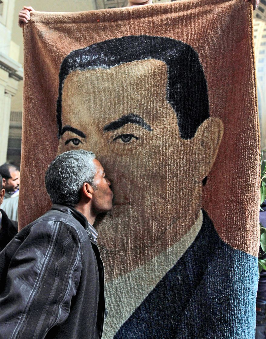 A carpet with an image of ousted Egyptian President Hosni Mubarak is displayed by backers in Cairo after a court ordered a retrial Sunday on charges that he failed to prevent the killing of protesters during the 2011 uprising that toppled his regime. (Associated Press)