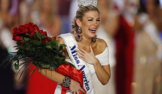 Miss New York Mallory Hagan reacts after being crowned Miss America 2013 on Saturday, Jan. 12, 2013, in Las Vegas. (AP Photo/Isaac Brekken)