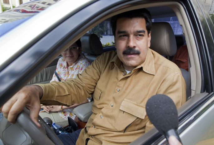 ** FILE ** Venezuelan Vice President Nicolas Maduro speaks to a reporter before driving away from the National Hotel in Havana, where he met with Argentine President Cristina Fernandez de Kirchner on Saturday, Jan. 12, 2013. Mr. Maduro and Mrs. Fernandez are in Cuba to visit ailing Venezuelan President Hugo Chavez, who is fighting a severe respiratory infection a month after undergoing cancer surgery in the Cuban capital. (AP Photo/Ramon Espinosa)