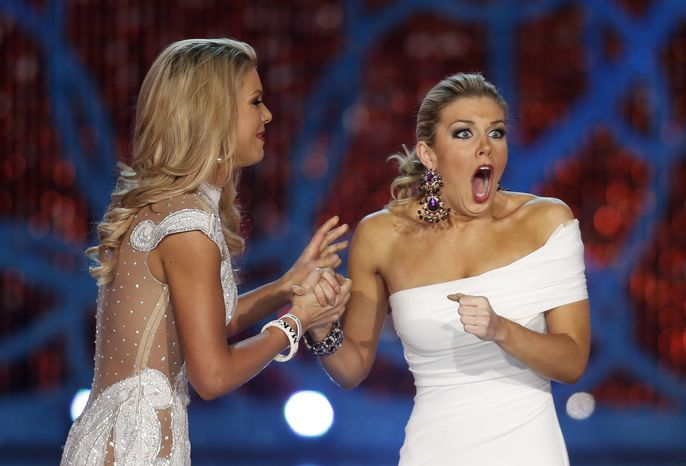 Miss New York Mallory Hagan (right), with Miss South Carolina Ali Rogers, reacts as she is named Miss America 2013 on Saturday, Jan. 12, 2013, in Las Vegas. (AP Photo/Isaac Brekken)