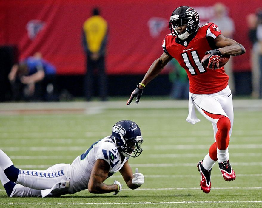 Atlanta Falcons wide receiver Julio Jones (11) runs past Seattle Seahawks cornerback Brandon Browner (39) during the first half of an NFC divisional playoff NFL football game Sunday, Jan. 13, 2013, in Atlanta. (AP Photo/John Bazemore)