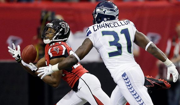 Atlanta Falcons wide receiver Roddy White (84) makes a touch-down catch against Seattle Seahawks strong safety Kam Chancellor (31) during the first half of an NFC divisional playoff NFL football game Sunday, Jan. 13, 2013, in Atlanta. (AP Photo/David Goldman)