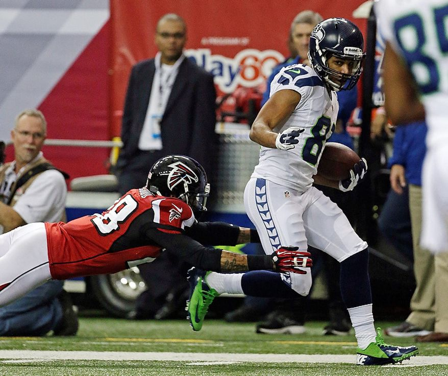 Seattle Seahawks wide receiver Golden Tate catches a touchdown pass in front of Atlanta Falcons free safety Thomas DeCoud (28)  during the second half of an NFC divisional playoff NFL football game Sunday, Jan. 13, 2013, in Atlanta. (AP Photo/Dave Martin)