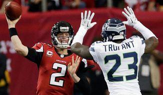 Atlanta Falcons quarterback Matt Ryan (2) throws against Seattle Seahawks cornerback Marcus Trufant (23) during the second half of an NFC divisional playoff NFL football game Sunday, Jan. 13, 2013, in Atlanta. (AP Photo/Dave Martin)