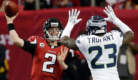 Atlanta Falcons quarterback Matt Ryan (2) throws against Seattle Seahawks cornerback Marcus Trufant (23) during the second half of an NFC divisional playoff NFL football game Sunday, Jan. 13, 2013, in Atlanta. (AP Photo/Dave Martin)