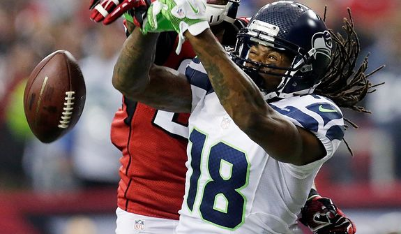 Atlanta Falcons free safety Thomas DeCoud (28) breaks up a pass intended for Seattle Seahawks wide receiver Sidney Rice (18) during the second half of an NFC divisional playoff NFL football game Sunday, Jan. 13, 2013, in Atlanta. The Falcons won 30-28. (AP Photo/Dave Martin)