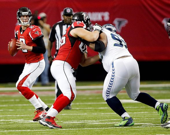 Atlanta Falcons guard Peter Konz (66) blocks Seattle Seahawks defensive tackle Brandon Mebane (92) as quarterback Matt Ryan (2) drops back to pass during the second half of an NFC divisional playoff NFL football game Sunday, Jan. 13, 2013, in Atlanta. (AP Photo/John Bazemore)