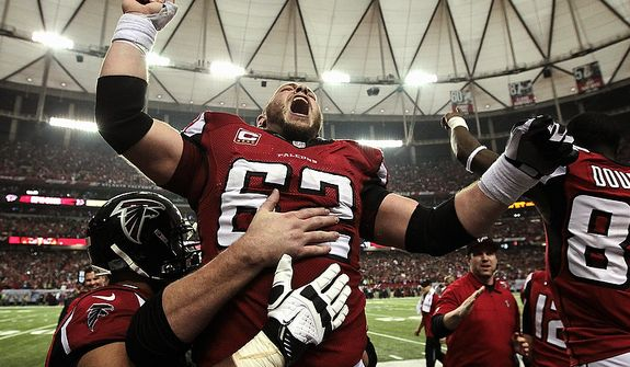 Atlanta Falcons center Todd McClure (62) celebrates on the sidelines following kicker Matt Bryant's winning 49-yard field goal against the Seattle Seahawks during the fourth quarter of their NFC divisional playoff NFL football game, Sunday, Jan. 13, 2013, in Atlanta. The Falcons won 30-28. (AP Photo/Atlanta Journal-Constitution, Curtis Compton)