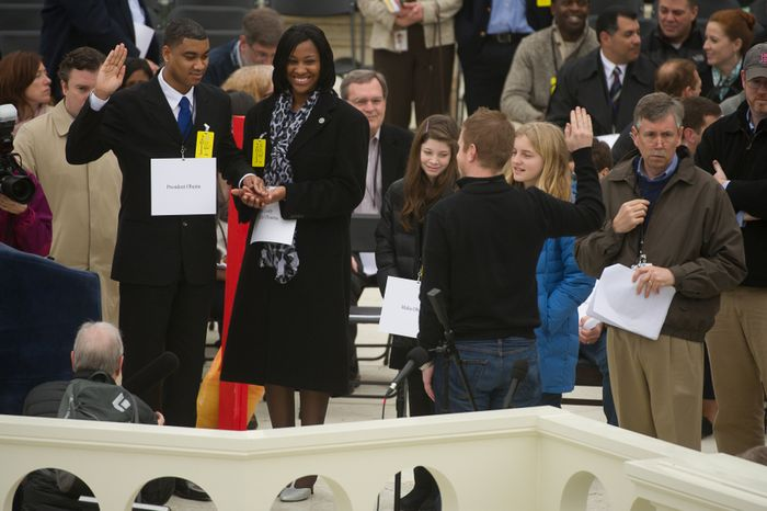 U.S. Air Force Staff Sgt. Serpico D. Elliot (left) and Army Spc. Delandra Rollins (second from left) stand in for President Obama and first lady Michelle Obama during the presidential inaugural rehearsal on the West Lawn of the U.S. Capitol in Washington on Sunday, Jan. 13, 2013. Also pictured are Quincy McElhaney (fourth from right) and Marie Clare Paxton (second from right) as Sasha and Malia Obama. (Andrew Harnik/The Washington Times)