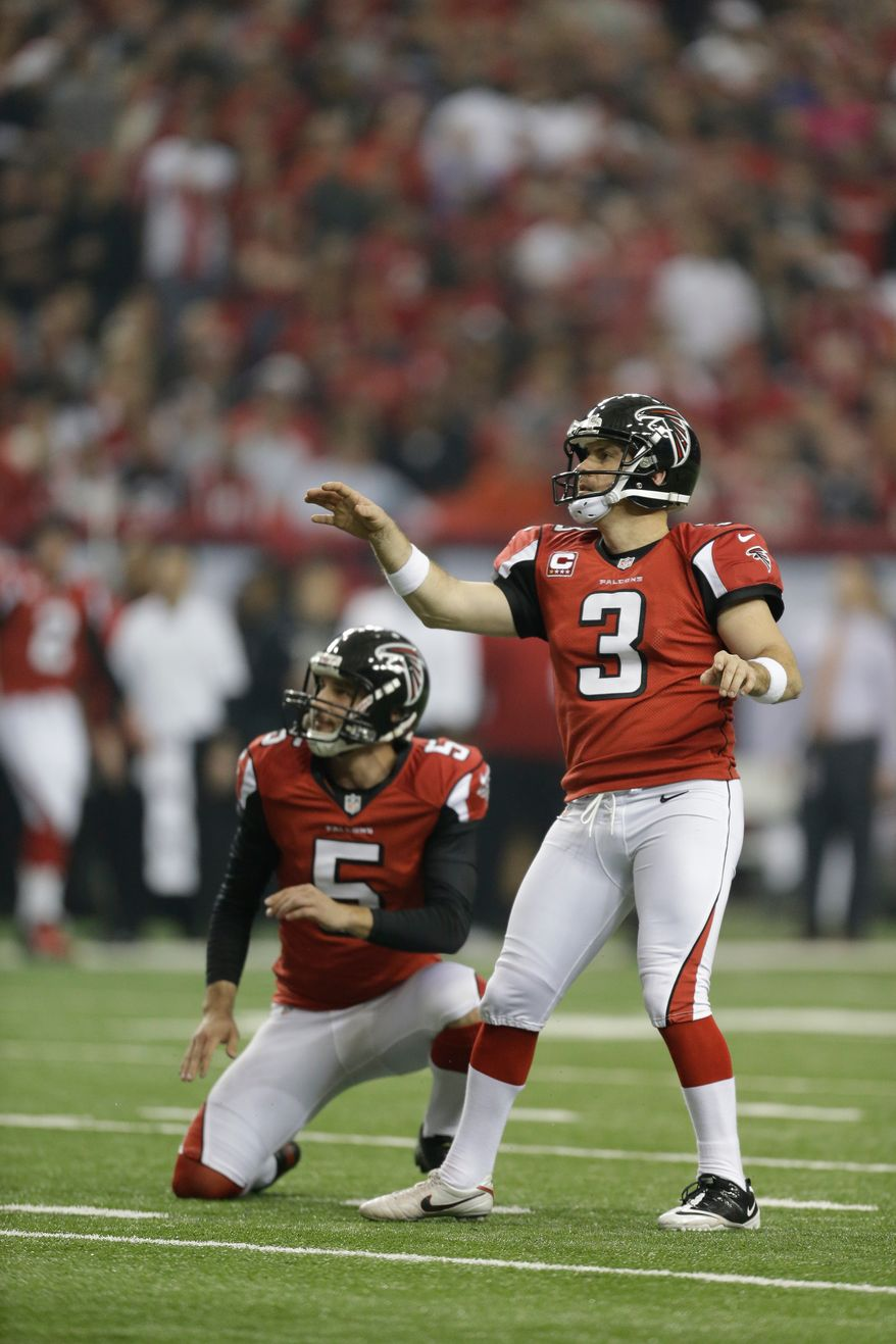 Atlanta Falcons kicker Matt Bryant (3) watches his field goal kick as Atlanta Falcons' Matt Bosher (5) looks on during the first half of an NFC divisional playoff NFL football game against the Seattle Seahawks Sunday, Jan. 13, 2013, in Atlanta. (AP Photo/David Goldman)