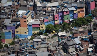 "They may not be much to look at now but the hillside homes in the Rocinha slum in Rio de Janeiro offer a great view. Investors are snapping up property in Rio's slums as police move in to ""pacify"" the communities and reduce the criminal presence before the 2014 soccer World Cup and 2016 Olympics. (Associated Press)"