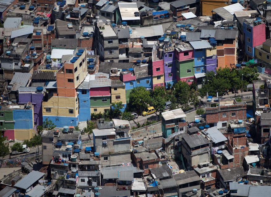 """They may not be much to look at now but the hillside homes in the Rocinha slum in Rio de Janeiro offer a great view. Investors are snapping up property in Rio's slums as police move in to """"pacify"""" the communities and reduce the criminal presence before the 2014 soccer World Cup and 2016 Olympics. (Associated Press)"""