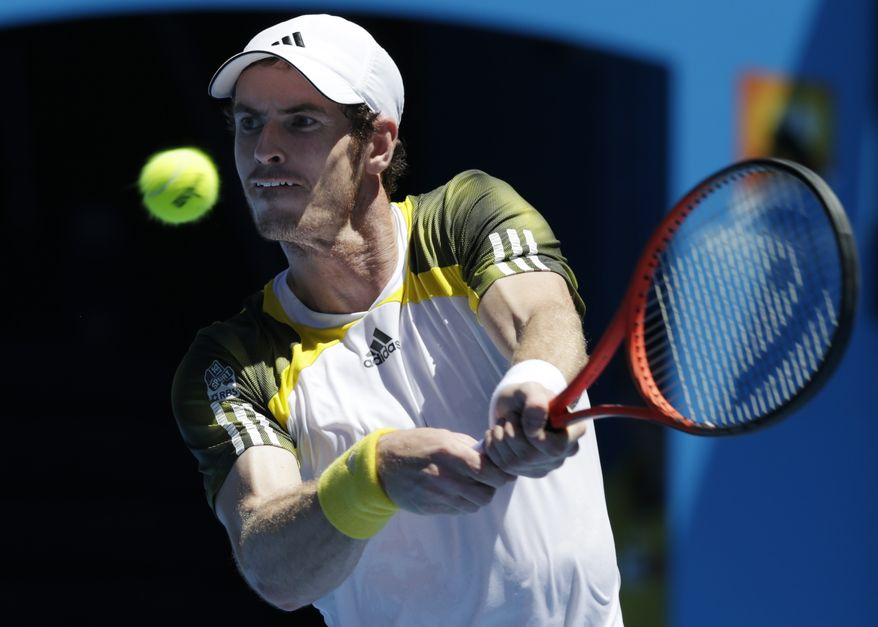 Andy Murray makes a backhand return to Robin Haase during their first-round match at the Australian Open in Melbourne, Australia, on Jan. 15, 2013. (Associated Press)