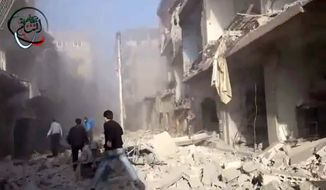 Syrians run to aid the injured in the aftermath of a strike by Syrian government warplanes on the residential neighborhood of Maadamiyeh, south of Damascus, Syria, on Monday, Jan. 14, 2013. (AP Photo/Shaam News Network via AP video)