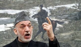** FILE ** Afghan President Hamid Karzai speaks during a press conference at the presidential palace in Kabul, Afghanistan, on Jan. 14, 2013. (Associated Press)