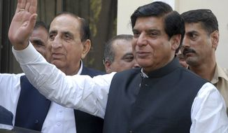 ** FILE ** In this Friday, June 22, 2012, file photo, Pakistan's Prime Minister Raja Pervaiz Ashraf waves in Islamabad, Pakistan. Pakistan's Supreme Court has ordered the arrest of the country's prime minister as part of a corruption case involving private power stations, officials said Tuesday, Jan. 15, 2013. (AP Photo/B.K. Bangash, File)