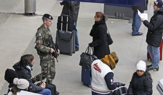 ** FILE ** A French soldier patrols the Gare du Nord train station in Paris on Monday, Jan. 14, 2013. France has ordered tightened security in public buildings and transport facilities following action against radical Islamists both in Mali and Somalia. (AP Photo/Remy de la Mauviniere)