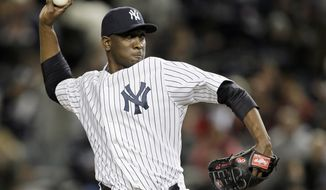 ** FILE ** In this Oct. 13, 2012, file photo, New York Yankees' pitcher Rafael Soriano throws in the tenth inning of Game 1 of baseball's American League championship series against the Detroit Tigers in New York. A person familiar with the negotiations says Soriano and the Washington Nationals are working to finalize a $28 million, two-year contract. The person spoke to The Associated Press on Tuesday, Jan. 15, 2013, on condition of anonymity because the deal had not been signed. (AP Photo/Matt Slocum)