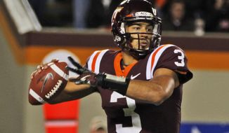 ** FILE ** In this Nov. 8, 2012 file photo, Virginia Tech quarterback Logan Thomas (3) looks to pass during the first half of a NCAA college football game in Blacksburg, Va. Thomas announced Tuesday he would return to school for his senior season. (AP Photo/Steve Helber)
