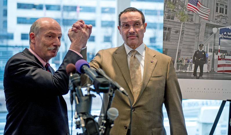"D.C. Council Chairman Phil Mendelson (left) and D.C. Mayor Vincent C. Gray unveiled the glass-enclosed, carpeted pavilion with a banner outside proclaiming, ""A more perfect union must include full Democracy in D.C."" (Andrew Harnik/The Washington Times)"