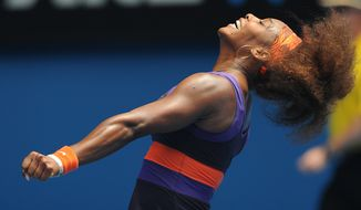 Serena Williams celebrates after defeating Garbine Muguruza in the second round of the Australian Open in Melbourne, Australia, on Jan. 17, 2013. (Associated Press)