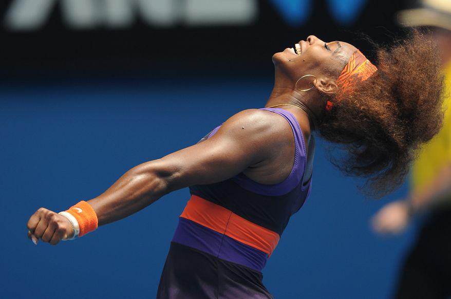 Serena Williams celebrates after defeating Garbine Muguruza in the second round of the Australian Open in Melbourne, Australia, on Jan. 17, 2013. (Associated Press)