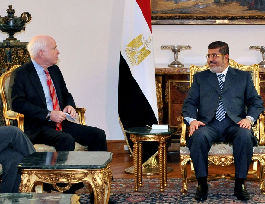 Egyptian President Mohammed Morsi (right) meets with U.S. Sen. John McCain, Arizona Republican, at the presidential palace in Cairo on Wednesday, Jan. 16, 2013. (AP Photo/Egyptian Presidency)