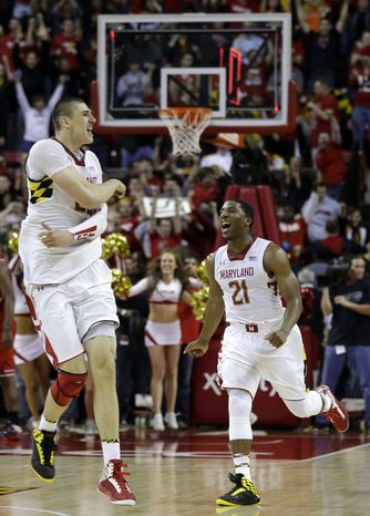 Maryland center Alex Len, left, of Ukraine, and guard Pe'Shon Howard (21) celebrate after North Carolina State was unable to make a last-second basket after an NCAA college basketball game in College Park, Md., Wednesday, Jan. 16, 2013. Maryland won 51-50. (AP Photo/Patrick Semansky)