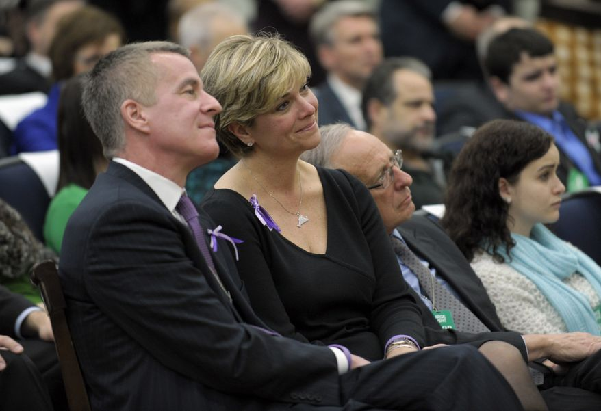 Lynn and Chris McDonnell, parents of Grace McDonnell, who was killed in the Newtown, Conn., school shooting, listen as President Obama talks about their daughter during a Jan. 16, 2013, news conference at the White House on proposals to reduce gun violence. (Associated Press)