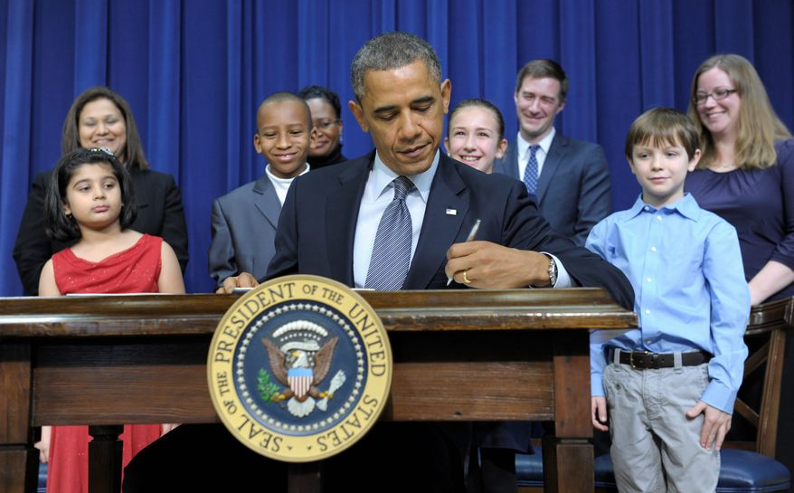 President Obama signed executive orders in the presence of children who wrote to him about gun violence. Among them were (from left) Hinna Zeejah, 8, and Nadia Zeejah, Hinna's mother; Taejah Goode, 10, and Kimberly Graves, Taejah's mother; Julia Stokes, 11, and Theophil Stokes, Julia's father; and Grant Fritz, 8, and Elisabeth Carlin, Grant's mother. (Associated Press)