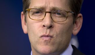 White House press secretary Jay Carney pauses to listen to a question a during his daily news briefing at the White House in Washington on Tuesday, Jan. 15, 2013. (AP Photo/Carolyn Kaster)