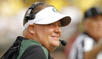 FILE - This Sept. 8, 2012 file photo shows Oregon coach Chip Kelly looking to the scoreboard during the first half of an NCAA college football game against Fresno State in Eugene, Ore. (AP Photo/Don Ryan, FIle)