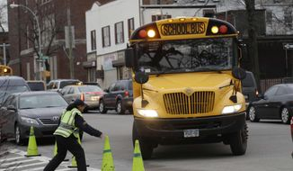 ** FILE ** A school bus arrives to drop off students in New York, Tuesday, Jan. 15, 2013. A strike by New York City school bus drivers that had been threatened for weeks will start Wednesday, Jan. 16, 2013, affecting 152,000 students, the president of the union representing the drivers announced on Monday, Jan. 14, 2013. (AP Photo/Seth Wenig)