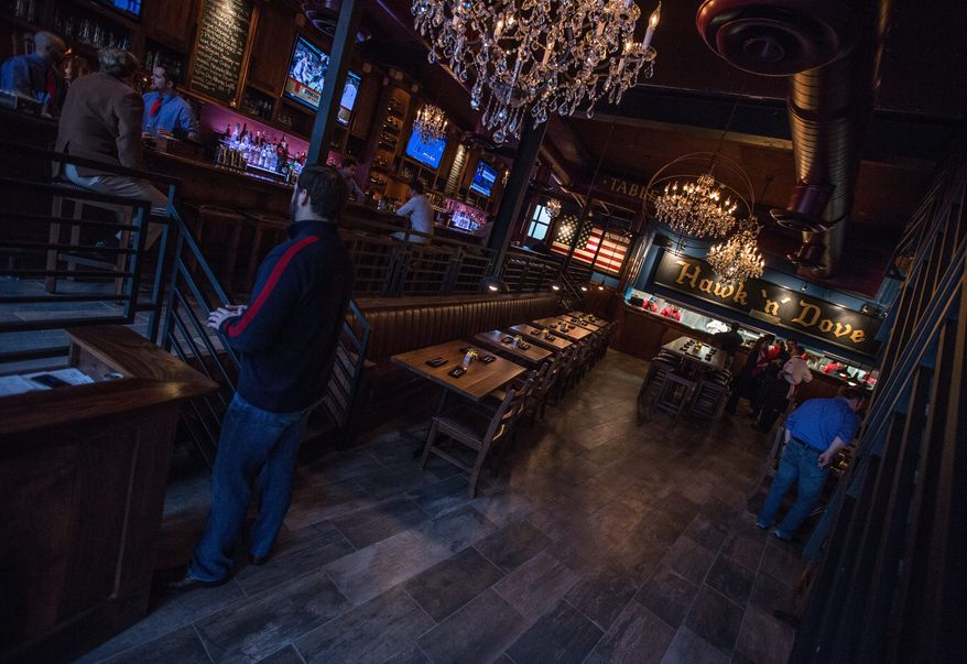 The newly reopened Hawk 'n' Dove on Capitol Hill has been remodeled and updated with a modern interior but is still in its old location on Capitol Hill. (Andrew S. Geraci/The Washington Times)