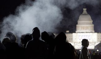 For President Obama's first inauguration four years ago, a steam vent on the Mall keeps people warm in the early morning of Jan. 20, hours before the ceremony. The forecast for Monday's swearing-in is temperatures in the mid- to upper 30s. (Associated Press)